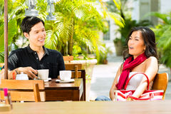 Asian man and woman in restaurant or cafe Stock Photos