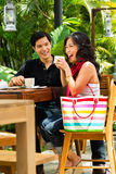 Asian man and woman in restaurant or cafe Royalty Free Stock Photos