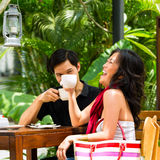 Asian man and woman in restaurant or cafe Stock Photography