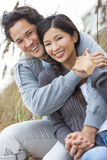 Asian Man Woman Romantic Couple on Beach Dunes Royalty Free Stock Images