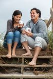 Asian Man Woman Romantic Couple on Beach Steps royalty free stock images