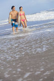 Asian Man Woman Surfers on Beach Stock Photo