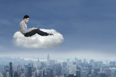 Asian man working on a cloud Royalty Free Stock Photos
