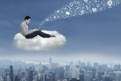 Asian man working on a cloud 1 Royalty Free Stock Image