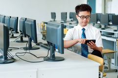 Asian man working in the computer room Stock Image