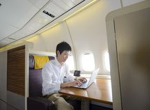 Asian man working on first class airplane Stock Images