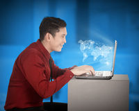 Asian man working with laptop with world map networking Stock Photo