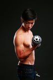 Asian man working out with dumbbell Royalty Free Stock Photo