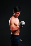 Asian man working out with dumbbell Royalty Free Stock Photos