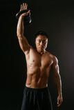 Asian man working out with kettle bell Stock Photography