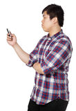 Asian man writing message on mobile phone Stock Photography