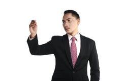 Asian Man Writing Something Stock Photo