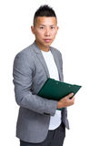 Asian manager holding clipboard Royalty Free Stock Photography