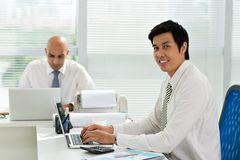 Asian manager. Portrait of Asian manager working in the office Royalty Free Stock Image