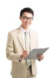 Asian manager. Smiling Asian manager standing with documents Royalty Free Stock Image