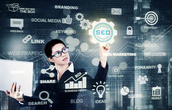 Asian manager touching SEO button Royalty Free Stock Photos