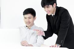 Asian manger businessman and employee salary man has working tog. Asian manger businessman and employee salary men has working together with feeling happy and royalty free stock photos
