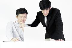 Asian manger businessman and employee salary man has working tog. Asian manger businessman and employee salary men has working together with feeling happy and royalty free stock photography