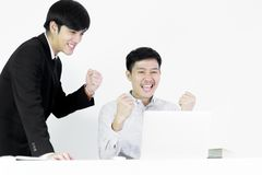 Asian manger businessman and employee salary man has working tog. Asian manger businessman and employee salary men has working together with feeling happy and stock photos