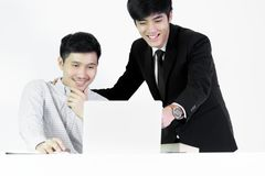 Asian manger businessman and employee salary man has working tog. Asian manger businessman and employee salary men has working together with feeling happy and royalty free stock images