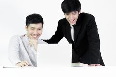 Asian manger businessman and employee salary man has working tog. Asian manger businessman and employee salary men has working together with feeling happy and stock photography