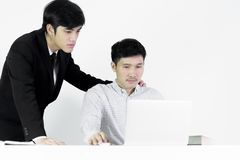 Asian manger businessman and employee salary man has working tog. Asian manger businessman and employee salary men has working together with feeling happy and stock image