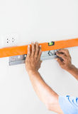 Asian Mans Hand Measuring A Wall With Spirit Level Stock Photography