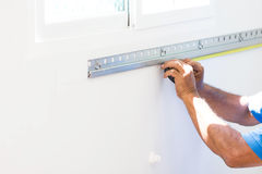 Asian Mans Measuring A Wall With Measure Tape Preparing To Build Stock Photos