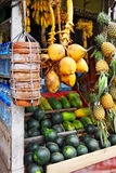 Asian market. Coconuts, bananas, pineapples, watermelons and curd pots Stock Photo