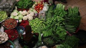 Asian market, Kota Bharu, Malaysia. Person buys food on traditional asian market named Pasar siti khadijah in the city of Kota Bharu, Malaysia stock video