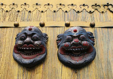Asian masks on a gold door Stock Image