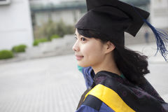 Asian master girl graduate looking for future Royalty Free Stock Images