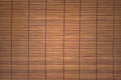 The asian mat from yellow bamboo Royalty Free Stock Photos