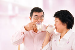 Asian mature couple drinking soy milk Royalty Free Stock Photography