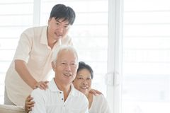 Asian mature son and old parents at home. Portrait of happy Asian family at home, old parents and mature son indoor lifestyle Stock Images