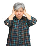 Asian mature woman closing ears with hands Royalty Free Stock Image