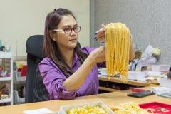 Asian mature woman smiling working. Stock Photos