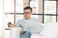 Asian matured male online Royalty Free Stock Image