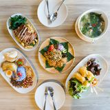 Asian meal dishes including Laphet, Nasi Lemak, Drunken Noodles with grilled pork, Grilled sticky rice with egg and Hot and Spicy. Soup with Pork Rib Stock Photos