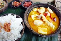 Asian meal - Sea food curry with rice Stock Photos