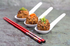 Asian meatballs and chopsticks Stock Photography