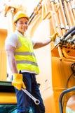 Asian mechanic at machine maintenance Stock Images