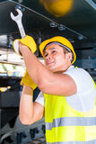 Asian mechanic repairing construction vehicle Royalty Free Stock Image