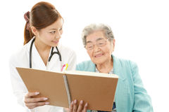 Asian medical doctor and senior woman Royalty Free Stock Photography