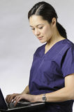 Asian medical person with computer. Stock Images