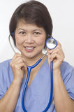 Asian medical professional with stethoscope Stock Images