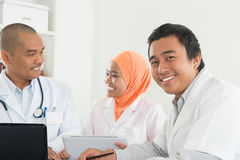 Asian medical team meeting at hospital office. stock photography