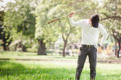 Asian men angry golfer. Asian man angry golfer trying to break his club royalty free stock photos