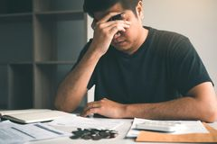 Free Asian Men Are Stressed About Financial Problems, With Invoices And Calculators Placed On The Table While Having Stress On Problems Royalty Free Stock Photography - 154558987