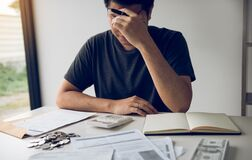 Free Asian Men Are Stressed About Financial Problems, With Invoices And Calculators Placed On The Table While Having Stress On Problems Royalty Free Stock Images - 179935419